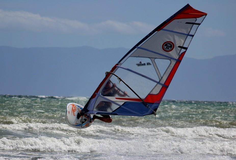 Windsurfing off Strand beach, Western Cape, South Africa.
