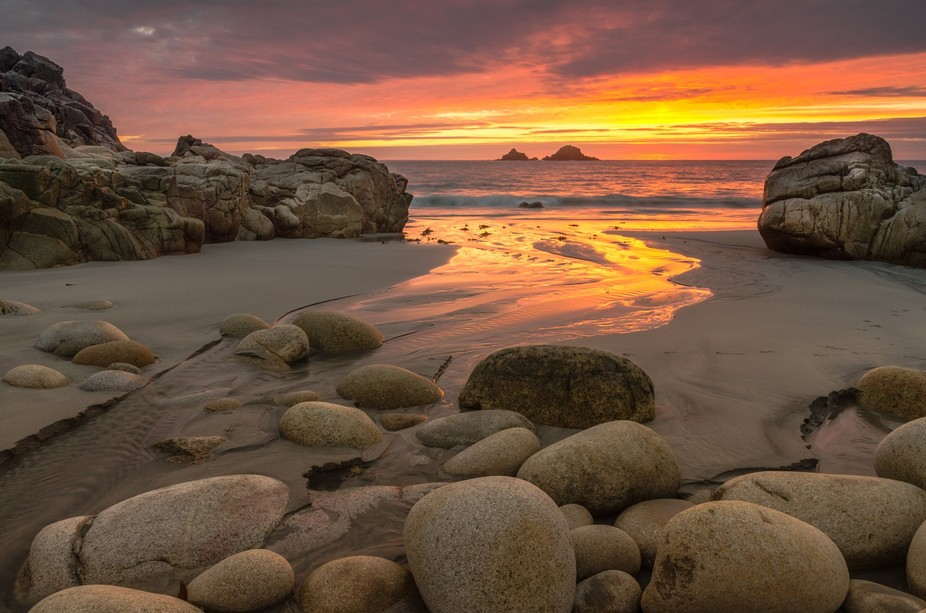The iconic beach in Cornwall, UK, on a fiery sunset in spring 2014