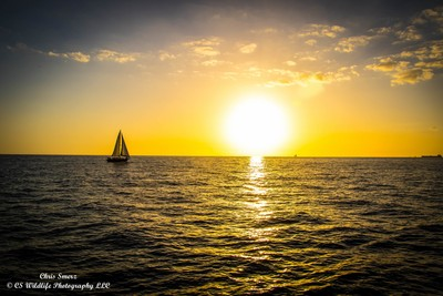 Sunset and sailboat in Hawaii