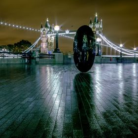 Typical rainy evening in London, with the Tower Bridge in the background behind a black egg. 