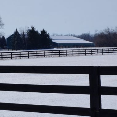 barn and fence in snow scene