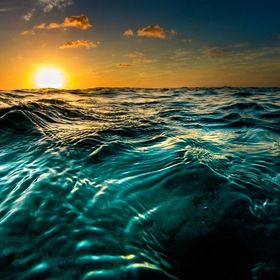 Ocean surface at sunset, shot from  a low prospective on the water.