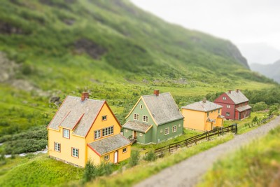Norwegian houses surrounded by green mountains