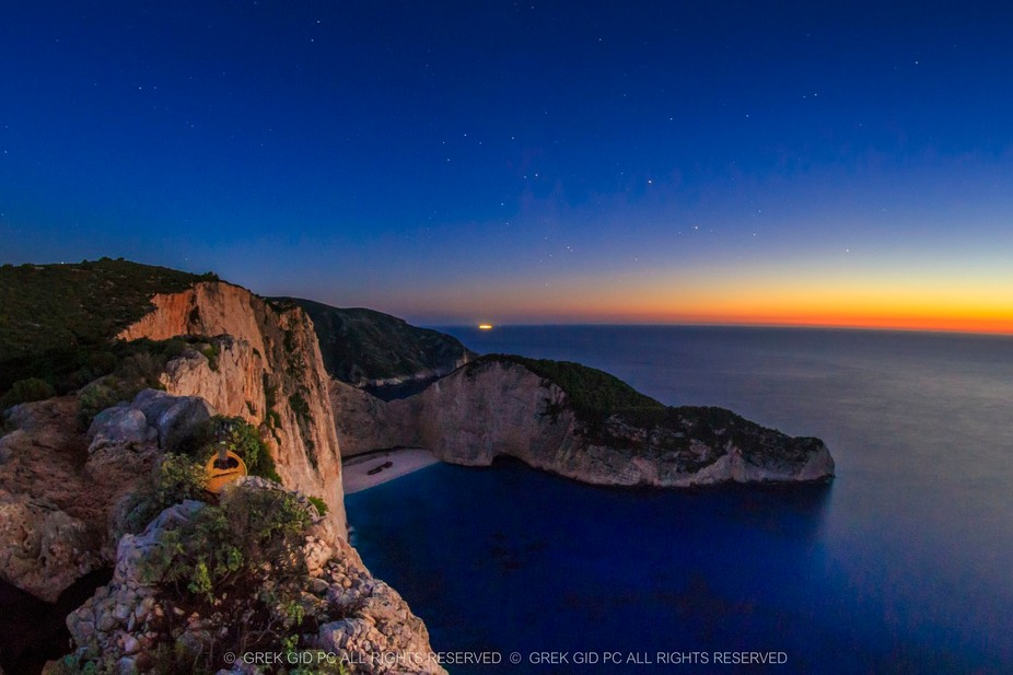 The amazing Navagio beach (Shipwreck) in Zakynthos, Greece after sunset! In the back there is a p...
