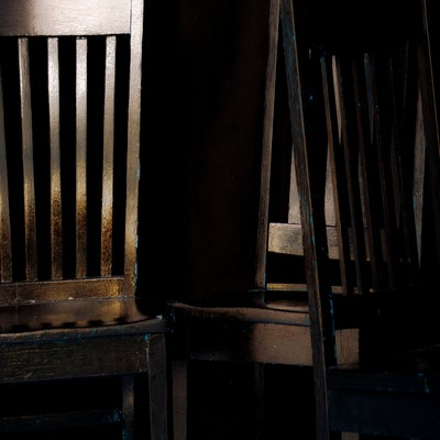 3 chairs in golden light