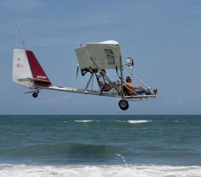 Low Flying Glider Plane Near Shore