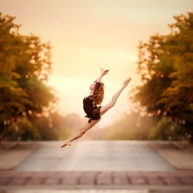 Dancer leaping across the street in downtown Oklahoma City  Kate Luber is a central Oklahoma portrait photographer and digital artist specializin...