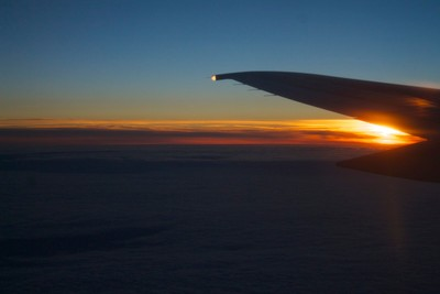 Sunset reflecting off the wing of the plane