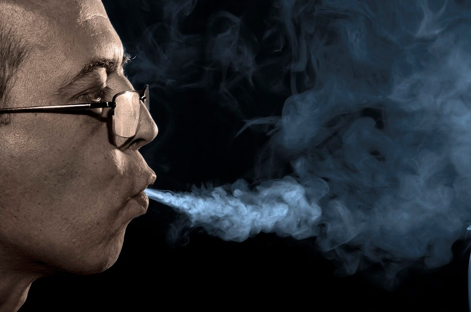 The man smoker jetting of tobacco smoke