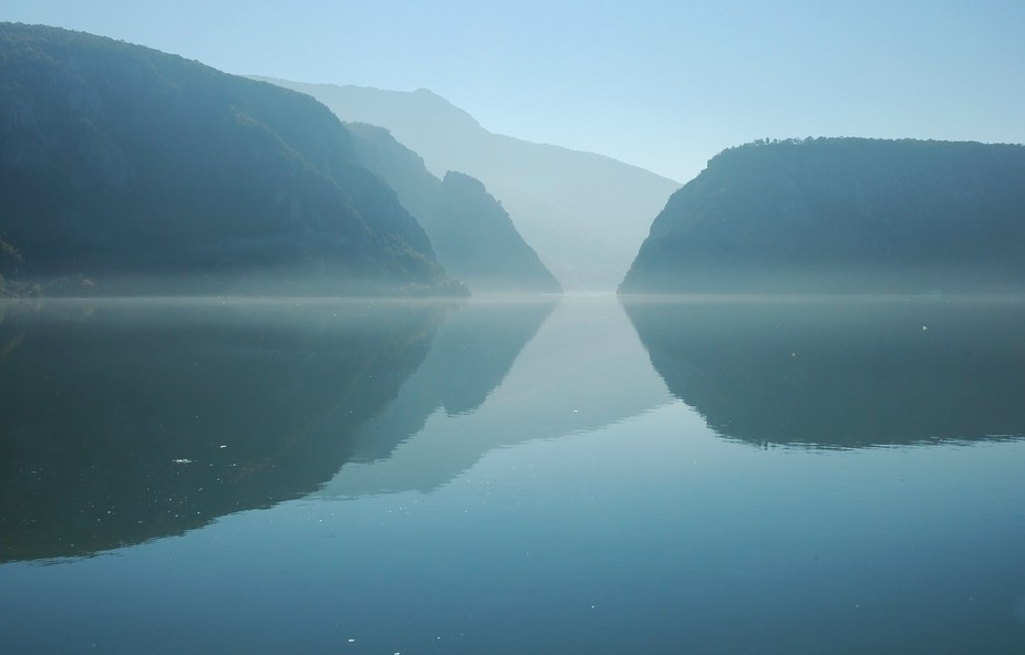 The Danube gorge in morning light. The gorge, and the river is a natural border between Romania a...
