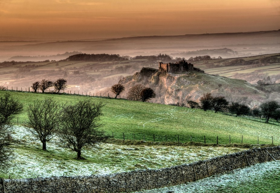 Carreg Cennen castle at sunset in the mist