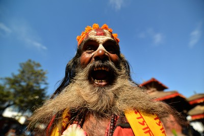 Holy Sadhu man with long beard and traditional painted face