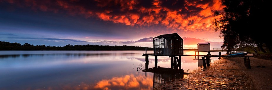 An amazing sunrise at Maroochy river Australia. It wasn\'t easy getting a photo without the rowers...