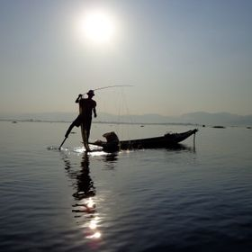 Fishermen on Inle Lake in Burma row with one foot in order to have hands for fishing