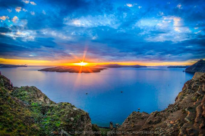 Sunset in Santorine.... by panoslykourgiwtis - Sun Flares Photo Contest