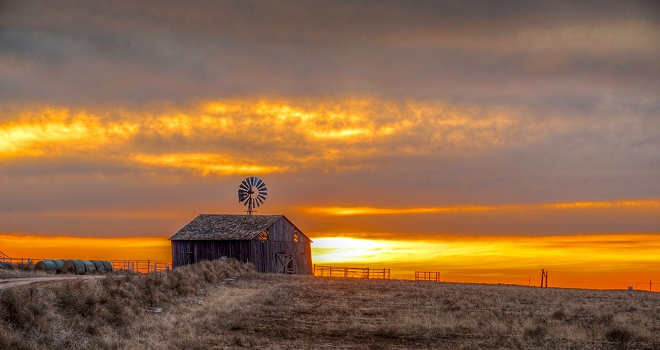 Saw this barn sitting on a small rise as the sun was going down in the background. Saw some of th...