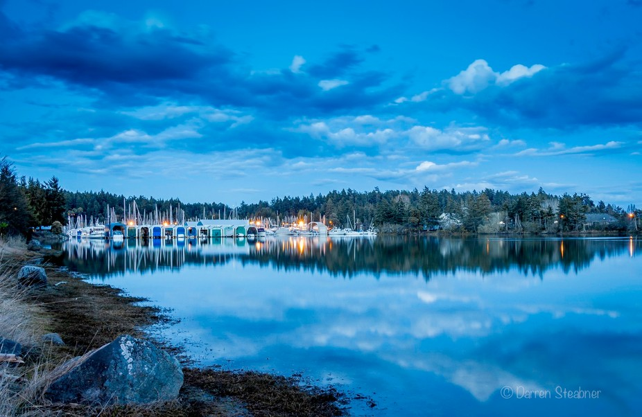 late evening at the marina with the calm water reflection.