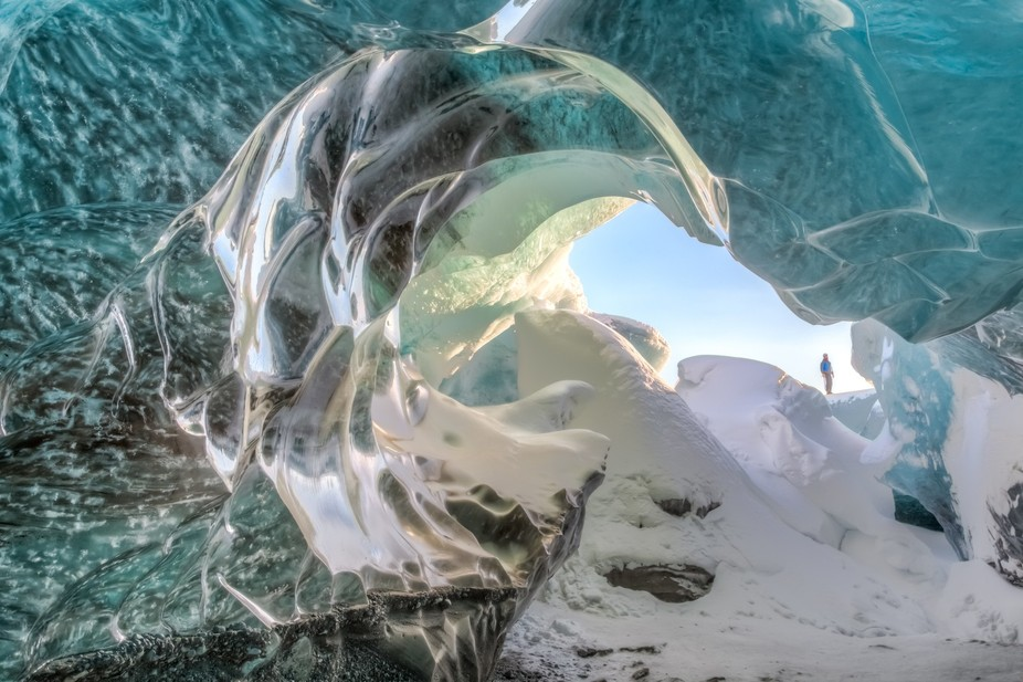 Looking out from inside an ice cave underneath an Icelandic Glacier