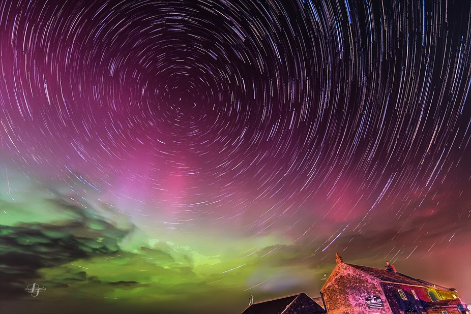 Magnificent Northern lights display and a star trail