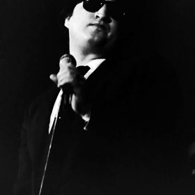 John Belushi as Jake Blues during a Blues Brothers musical performance;  New Year's Eve 1978 (12-31-78) Winterland Ballroom, San Francisco, Calif...