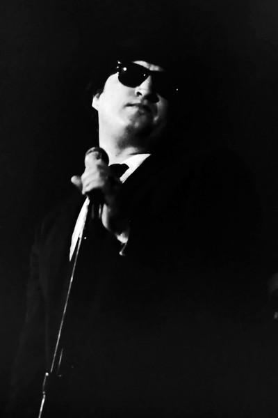 John Belushi as Jake Blues