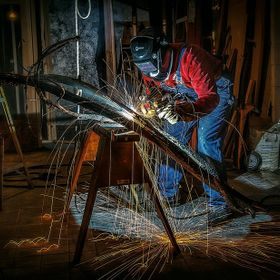 Artist welder working on a sculpture.