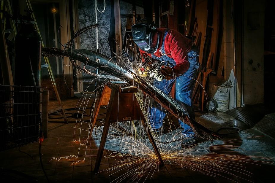 Artist welder working on a sculpture.