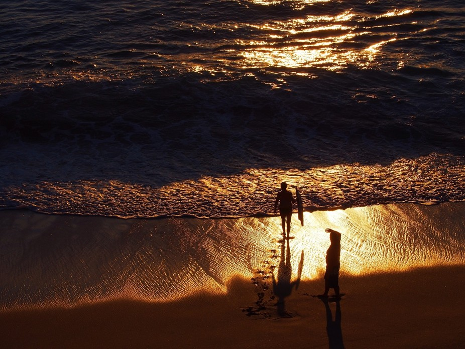 Last bit of light to body board. The most beautiful time of the day when the ocean is like surfin...