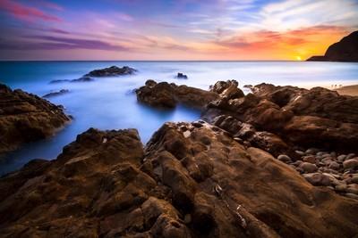 Last light on rocky shoreline
