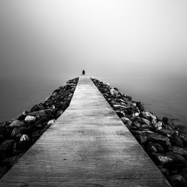 A lonely girl at the end of the bridge. Spaces in time photo series