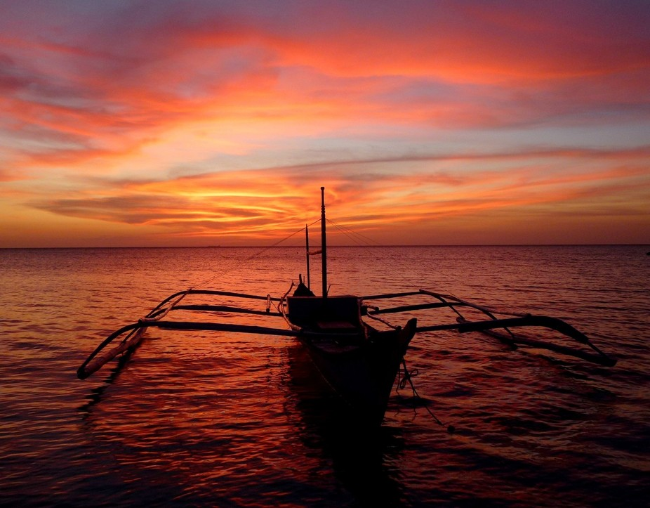 thge banca is a Filipino fishing boat with outriggeres;