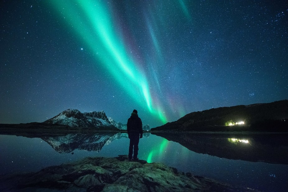 This is my friend Jørn standing and watching the Northern Lights this month near Haukland, Lofot...