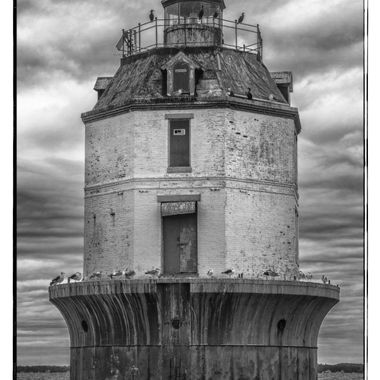 Cheapeake Bay Lighthouse in need of repair --- missing the railing on a dark and stormy day ----- not looking good - but still working!