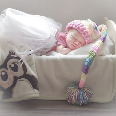 Newborn photo shoot, taken directly under a large window. Beautiful baby girl Brooklyn.