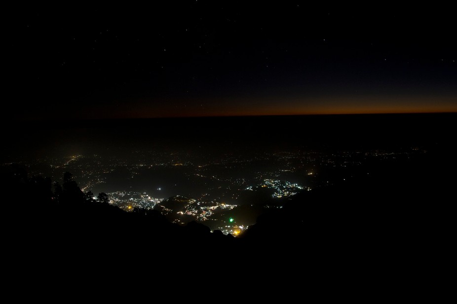 We were on a trek to Triund in Himachal Pradesh, India. This shot of Mcloadganj was taken from th...