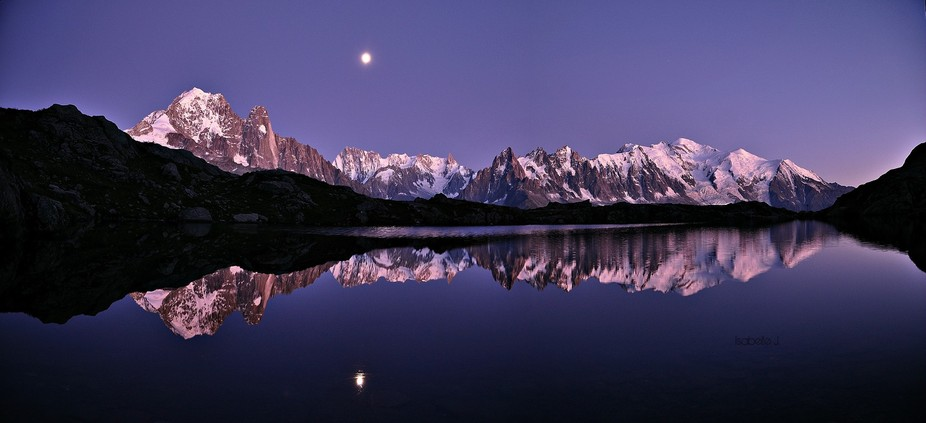 Sunset above the Mont Blanc Massif, french Alps. The Moon climbed The Drus (on the left) and quic...