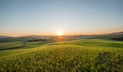 Sunset over the meadows of Tuscany