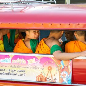 I've always viewed monks in their colorful robes with an other worldly status.. yet this image provides a more intimate