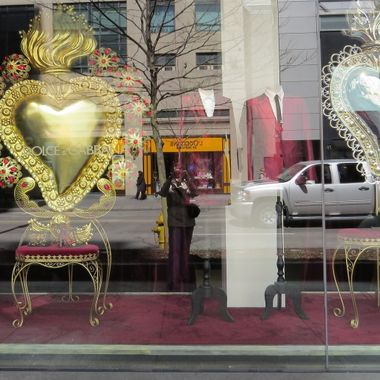 Whimsical display window for Dolce & Gabbana on Bloor Street in Toronto, Ontario. You can see me, the photographer, reflected in the window pane.