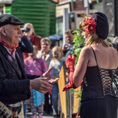 A 1940s re-enactment took place in Colwyn Bay in April 2015 with various people in period dress walking around and interacting with the public. in this case a member of the French Resistance and a French lady dance in the street.