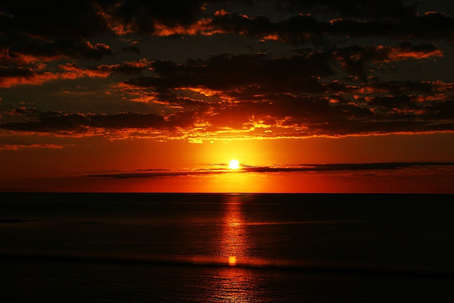 A beautiful red sunset glimmering over the ocean