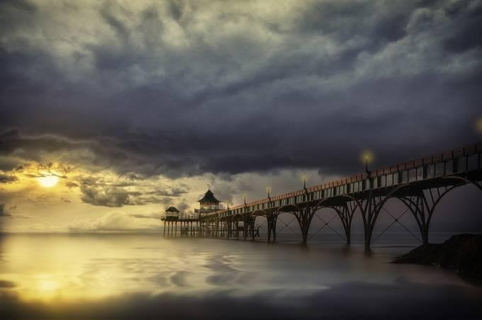 pier at sunset by antonyz