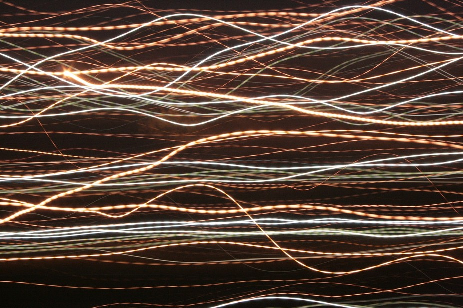 The pulsing of the lines of colour are due, (I think!?), to the 50 Hertz power.