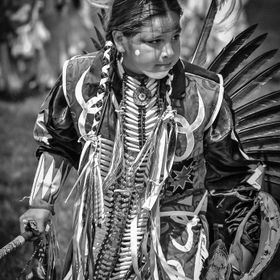 Black and White of a native Indian Boy dancing in a Pow Wow