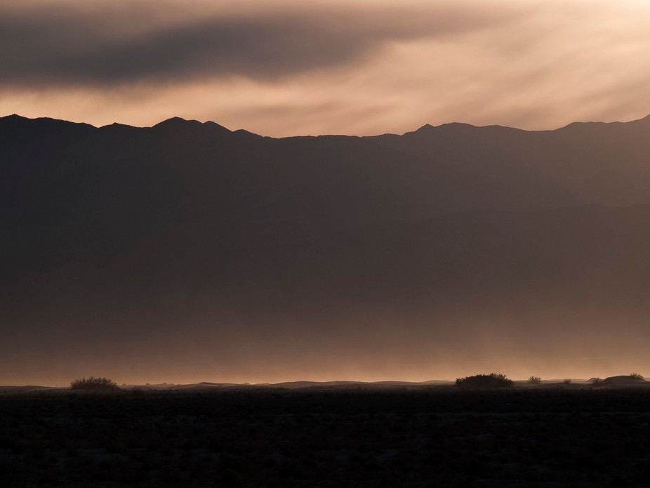 The sandstorm was being lit up by the ambient light at sunset.  This may look sepia but it was th...