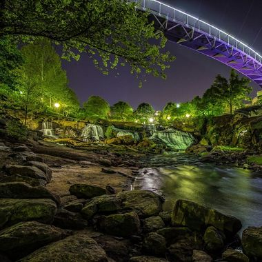 The Reedy River flows through Falls Park, Greenville, South Carolina