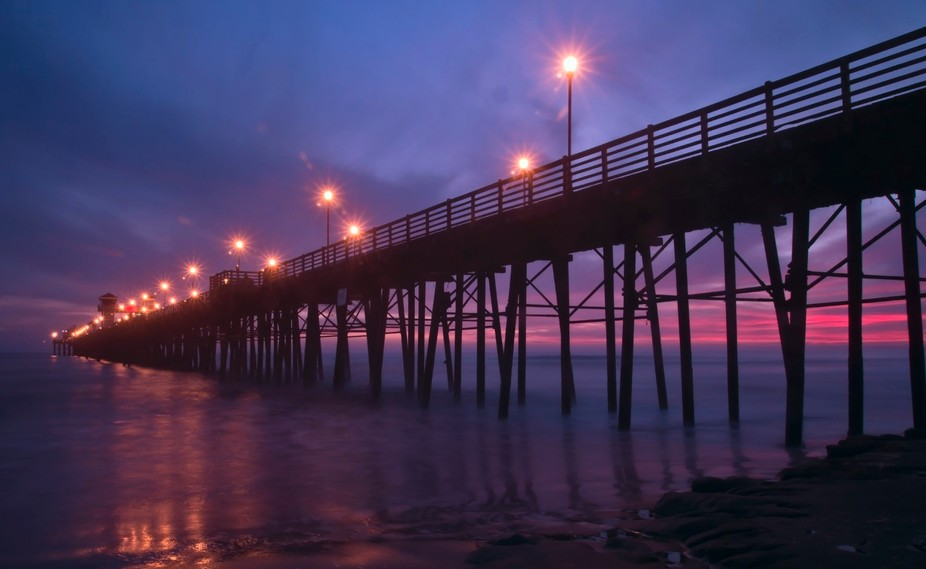 While the sunset still had some life left, I took this one just as the pier lights came on. No st...