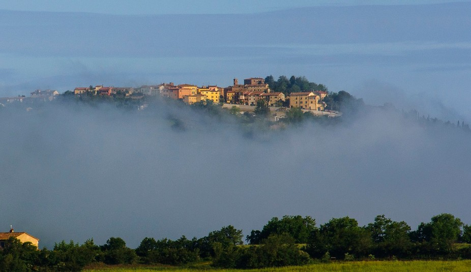 captured early in the morning. The fog was still in the valleys, but the village on the top of a ...