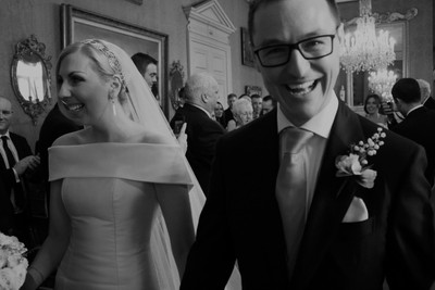 A very happy groom, just married, with his new wife.