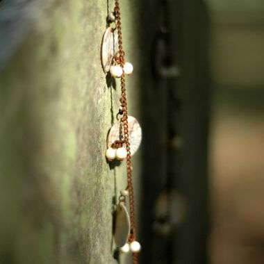 A necklace left on a gravestone in one of Houston's Historic Graveyards